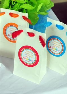 Rainbow party bags  - Good for brown bags too. Make holes and add a ribbon. X