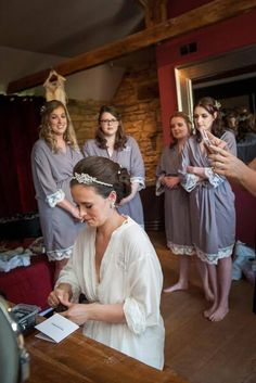 The Little Lovebird Real Brides wearing the Navy Lacie Robes bride robe d27bb3840