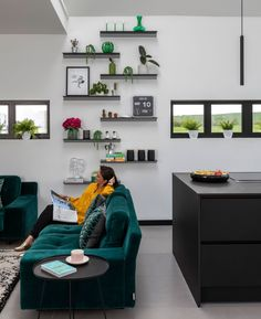 After seeing a Conran shelving system filled with plants on Instagram, Stephanie was inspired to find similar shelves for a fraction of the price. There's so much white space in here, you need something to draw the eye into the room and upwards. #openplan #livingroom #realhomes