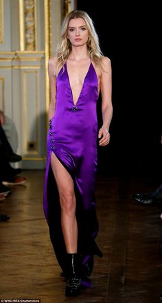 Showstopping beauty: Victoria's Secret Angel Lily Donaldson looked breathtaking in the Redemption Paris Fashion Week show on Friday in a revealing purple halterneck gown
