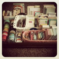 Project Life organization - love the little trays she keeps washi tape in. Looks like they might be for serving round crackers.
