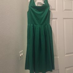 Green dress I ordered this from an online dress store and was vey disappointed myself because it was not what I expected. But my lose could be another's gain! Its never been worn Dresses