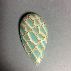 Crackled translucent turquoise polymer clay pendant.
