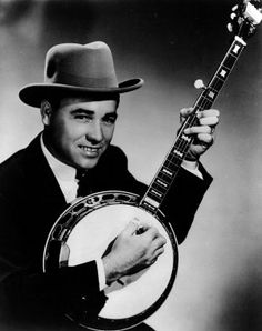 Earl Scruggs----- was a musician noted for perfecting and popularizing a three-finger banjo-picking style that is a defining characteristic of bluegrass music.