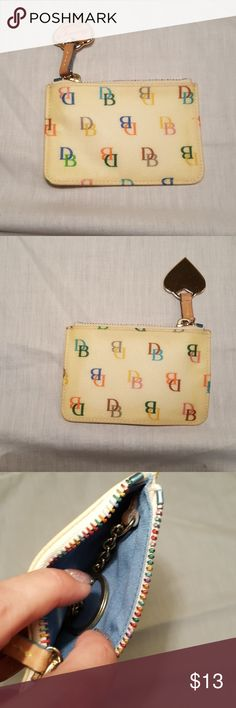 Dooney & bourke IT zip coin pouch Like new condition except the coated canvas is yellowed along edges. Smoke free pet free home Dooney & Bourke Bags Clutches & Wristlets