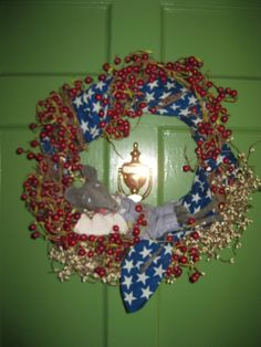 Fourth of July repose on the wreath.  He's quite a porch mouse!