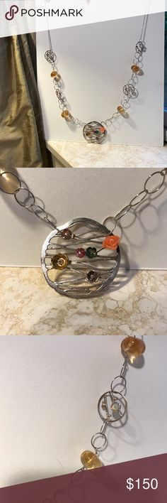 Exquisite one of a kind necklace Sterling silver with amber and assorted gemstone touched including opal, coral and diamond chip. Artist-designed piece. Approximately 25 inches. Bottom pendant and each of 4 circles has a different design and showcases different gems and metals. Jewelry Necklaces