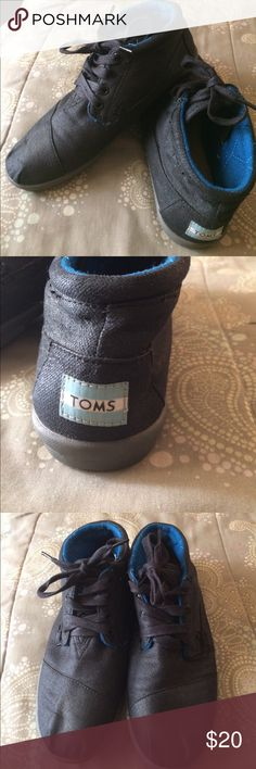 Ladies sneakers Sneakers by Toms. Black with blue quilted interior. These Toms are slightly higher, but not quite high tops. Good condition. TOMS Shoes Sneakers