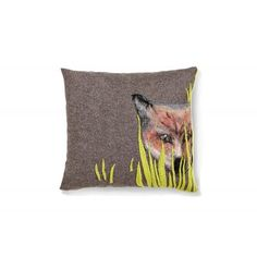 A decorative pillow of the Trophy series, shows fox looking behind the grass, potential trophy hunting. Made of knitted wool, decorated with felting technique. Details highlighted with hand stitching.