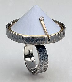 Andy Cooperman - Whitecap Ring - Sterling, gold, diamond and ping-pong ball.  Heat formed and carved, the cone shaped ball is set with the pickets cut from the sterling rim.