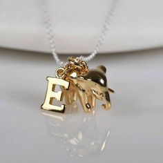 Nest Elephant Necklace With Personalised Letter Charm ($63) ❤ liked on Polyvore featuring jewelry, necklaces, nest necklace, letter charm necklace, elephant charm necklace, initial charms and initial jewelry