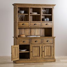 Manor Houses dark-stained oak finish and tongue-and-groove make this large dresser a stand out piece of furniture. The base comprises three shelved cupboards and three flat-fronted drawers, while the dresser top features shelved compartments and three more drawers.