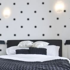 "Coronata Star Wall Decals from www.wallsneedlove.com (15.00) in a variety of colors. Standard size sheet comes with (28) 3"" stars and the Jumbo size sheet comes with (28) 5.5"" stars."