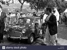 Download this stock image: John Whitmore-Paul Frere's Austin Mini-Cooper Twini in the Targa Florio, Sicily 5th May 1963. - DHCWB7 from Alamy's library of millions of high resolution stock photos, illustrations and vectors.