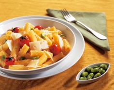 Pasta with fresh tomato, fava beans and pecorino cheese...  Rigatoni con pomodorini, fave e pecorino