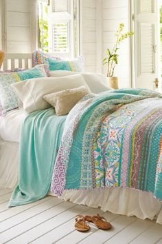 cool bedspread.  Inspired by the dramatic splendor of this town on Italy's Amalfi coast, our Positano Quilt is an exotic mix of color and pattern.