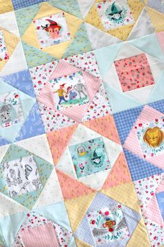 Two simple baby quilt ideas: Economy blocks using Dorothy's Journey - Wizard of Oz fabric fussy cuts and a simple denim and blues patchwork squares quilt. Quilt Baby, Baby Quilts Easy, Baby Patchwork Quilt, Baby Quilt Patterns, Cot Quilt, Baby Girl Quilts, Girls Quilts, Kid Quilts, Scrappy Quilts