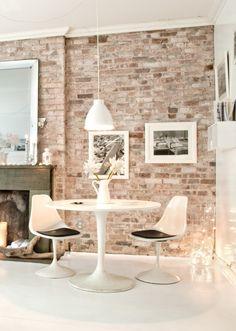 dining room brick wall - mid century pop white interior