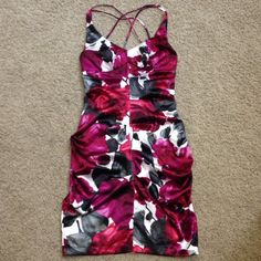 Gorgeous floral print stretch satiny dress Never got to wear this one!  it's so beautiful with spaghetti crisscross straps, lightly padded bust, hidden zipper and ruching to accentuate the body. Ruby Rox Dresses