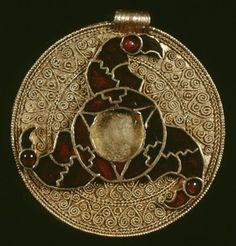 7th C. Gold disc pendant with cloisonné triskele of bird heads.