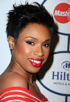 Jennifer Hudson at a Pre-Grammys Gala with cherry red lips, winged eyeliner, and a tousled pixie cut.