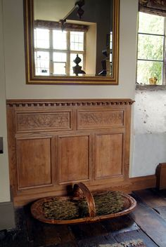 Dado panelling with hand carved frieze panels.jpg