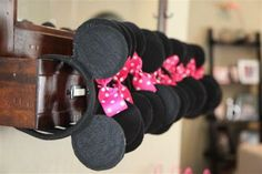 Forget the party favors. What cute way to store head bands    Minnie Mouse Party favors