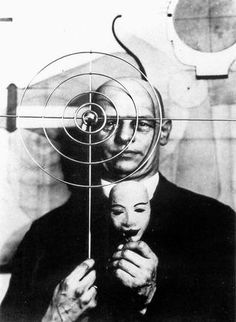 """Oskar Schlemmer (1888–1943), was a German painter, sculptor, designer and choreographer associated with the Bauhaus school. In 1923 he was hired as Master of Form at the Bauhaus theatre workshop, after working some time at the workshop of sculpture. His most famous work is """"Triadisches Ballett,"""" in which the actors are transfigured from the normal to geometrical shapes. Also in Slat Dance and Treppenwitz, the performers' costumes make them into living sculpture, as if part of the scenery."""