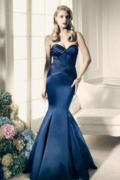 Strapless satin fit and flare gown with corset seam detailing and body-contouring pleats, £195. Zac Posen at David's Bridal