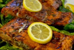Fast Paleo » Oven-Roasted Grill Plank Salmon with a Honey & Apple Balsamic Marinade served on a bed of Spinach