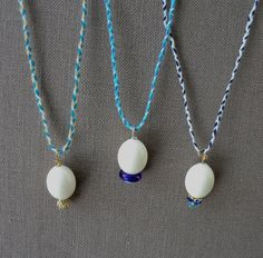 Lovely little half-inch egg pendants on cashmere and silk braided cords. Great for Easter, new baby or mom-to-be.