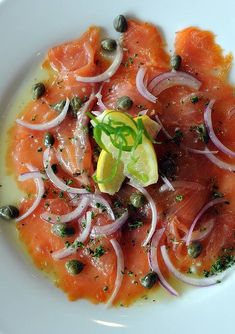 Carpaccio Di Salmone, thinly sliced smoked salmon marinated with garlic, capers, lemon and olive oil.