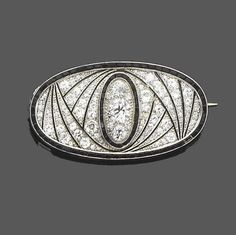 An art deco diamond, onyx and enamel brooch, circa 1930