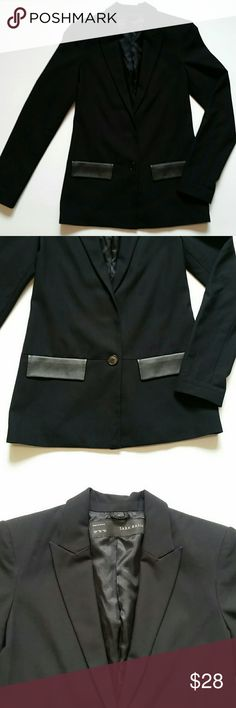 """Zara blazer.  Black hits at hips. Size XS. Zara basic black Blazer Size XS extra small. Made in Spain.  Material 65% polyester, 31% viscose, 4% elastane, lining 100% acetate. Vegan leather accent on the pocket area and collar. shoulder padded. In pre-loved excellent conditions. ALL MEASUREMENTS ARE APPROXIMATE: LENGHT: 26.5""""  PIT TO PIT: 16.5"""" WAIST: 16"""" SLEEVES : 24.5"""" Feel free to ask questions   I DO NOT TRADE Zara Jackets & Coats Blazers"""