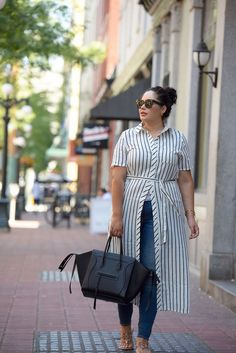 Tanesha Awasthi (formerly known as Girl with Curves) wearing a stripe shirtdress, skinny jeans