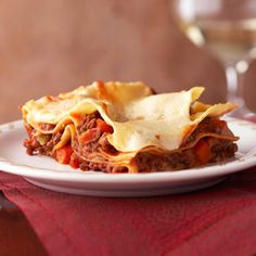 Meaty Lasagna Bolognese Don't be deterred by the lengthy ingredient list for this scrumptious Italian main dish recipe. This is the mother of all lasagnas, combining beef, sausage, pancetta, and white wine to name a few. Your family will think it's well worth the effort.