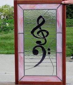 Bass and Treble Clef - I created this window as a thank you gift for my children's piano teacher at the end of eight years of friendship and work.  I asked her son in the hallways of the high school what his mom's favorite colors were.  Very confused, he answered pink and purple, and so the colors for the piece were chosen.