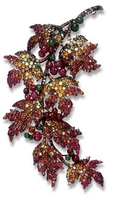 "Designed as an articulated foliate cascade, the pavé-set colored diamond, garnet, rubellite and multi-colored sapphire leaves, accented by ruby, carnelian and tourmaline beads, extending from a similarly-set stem, mounted in gold; and a smaller ""fallen leaf"" brooch of similar design, mounted in 18k white gold."