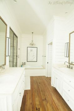 white painted plank walls and natural wood floors. White Plank Walls, White Oak Floors, Planked Walls, White Shiplap, Wood Floor Bathroom, White Bathroom, Bathroom Vanities, Bathroom Ideas, Bathroom Closet