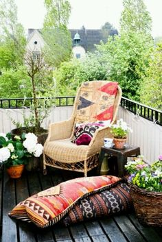 If you haven't got much space, a beautiful wicker chair and interesting cushion combo can make a perfect outdoor nook.