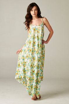 Flowing sensually Feminine Blossom Print Dress with Kerchief Hem.