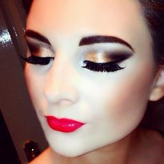 Dewy look with gold fading into dark brown smokey eyes, finished pink poppy lips. I also love an enhanced brow.