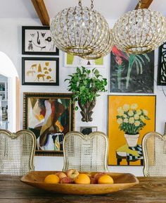 Boho eclectic dining room, love all the vintage style art on the gallery wall.