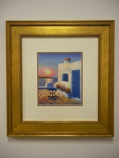 Small painting from vacation with larger frame makes a dramatic statement.