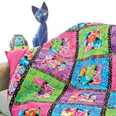 What's New Pussycat: McCall's Quilting Pattern. Great quilt for large prints. With neon cat fabric bordered with neon solids and black sashing.