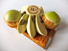 Saint Honore Pistache from the luxe patisserie of Hugo & Victor. Silky pistachio cream surrounded by two miniature filled cream filled profiteroles.