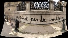 """This is not vandalism"""": graffiti on the wall of the Ecole des Beaux Arts, Paris, France"""