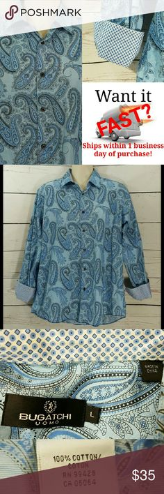 Bugatchi Uomo Blue Paisley Stylish Flip Cuff Shirt Bugatchi Uomo Blue Paisley Floral Casual Stylish Flip Cuff Shirt Size: L Large  About this item:  Mint Condition 100% Cotton Blue Paisley  Size: L Pit to Pit: 25 Length: 31 Uncuffed: 25 Cuffed: 22.5 Bugatchi Shirts Casual Button Down Shirts