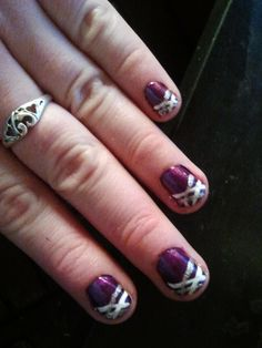 I love the look of decorated nails, it's just that I can never get mine to turn out.  This one looks pretty easy though, and purple and sliver is one of my favorite color combinations!