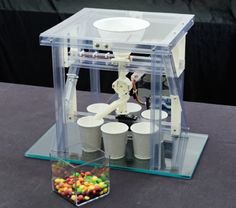 Tired of having to tediously pick through yellow and orange Skittles to find the red and purple ones? Then, you'll love this sweet sorting machine. #Atmel #Makers #Arduino #DIY #CandySorting